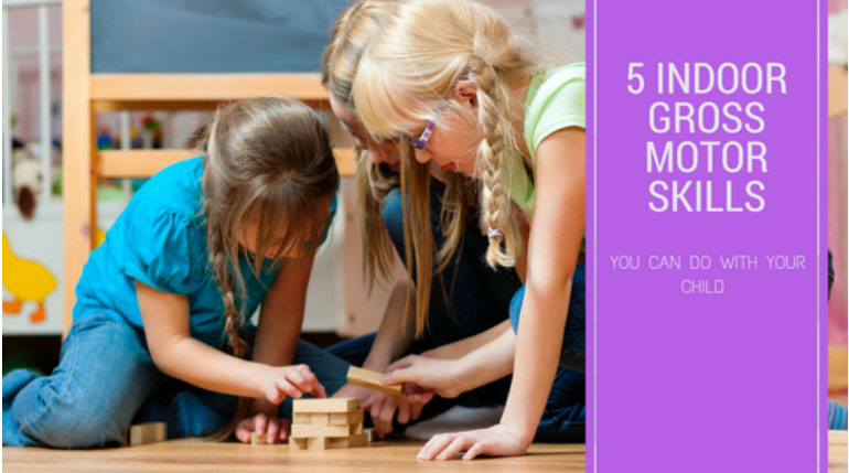 Group of preschool girls playing wood blocks with text 5 indoor gross motor skills at a Preschool & Daycare Serving Greenville, AL